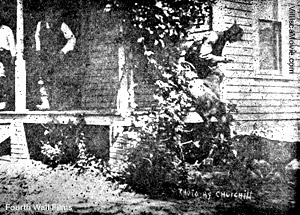 The Noffisinger bloodhounds leap off the porch of the Villisca ax murder house.