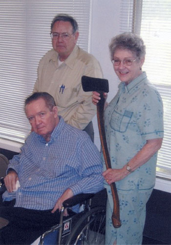 Don Brown, Dorothy Myer, and Ed Epperly with the axe.