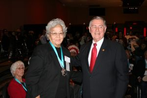 Mae Sine honored at AARP event.