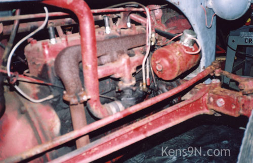 Ford 9N tractor engine inspection.