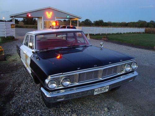 Cop car valle drive-inn