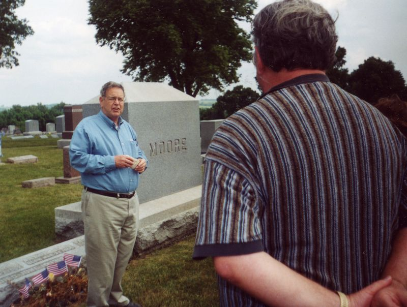 Eds cemetery talk at Moore gravestone