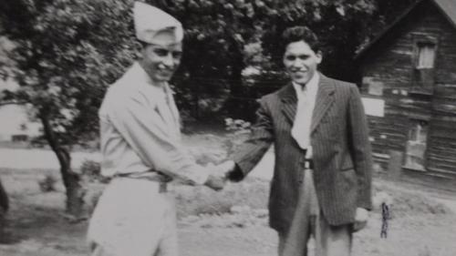 Willie shaking hand
